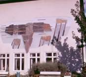 Ett konstverk på en fasad i Västervik.
