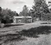 En enkelstuga i Misterhults hembygdsgård.