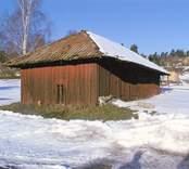 Vagnskjul med tälttak i Helgenäs.