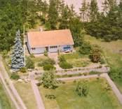 En villa med trädgård, i Luvehult.