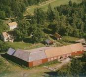 En ekonomibyggnad i Sankt Sigfrids socken.