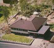 En villa med garage i Kristvalla socken.