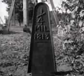 Milstolpe av gjutjärn 1/4 mil från 1813.