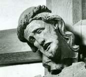 Detalj av triumfkrucifix av ek. Troligen ett gotländskt arbete från 1300-talets början.