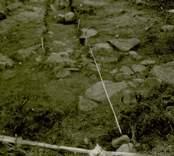 Arkeologisk undersökning  Boplats C1. Röjningsröse nordost om schakt (nordost-sydväst), från nordost.