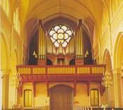 Vykort med motiv av orgelläktaren i Sankt Petri kyrka.