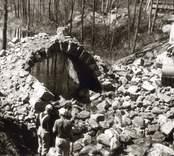 Utrivning av stenvalvbro.