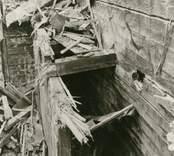 Hälleberga kyrka: Kyrkan brann ner 1976-10-18. Branden orsakades av ett elfel. Tornet i detalj mellanvägg i N.