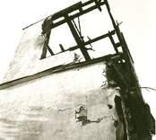 Hälleberga kyrka: Brandorsaken var ett elfel. Branden var 1976-10-18. Tornet under rivning södra sidan.