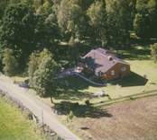 En villa med hammock i Sankt Sigfrids socken.