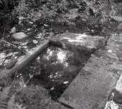 Resterna av Norrby brunn, hälsobrunn som har haft en överbyggnad.