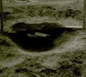 Arkeologisk undersökning  Boplats B. Anläggning 60, härd, profil från söder.