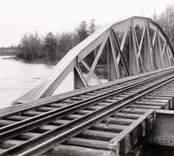 Järnvägsbron över Alsterån med sandslätts möbelfabrik i fonden år 1928.