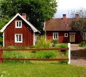 Mangårdsbyggnad och uthus på gården Rugstorp 1:13.
